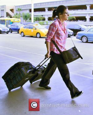 Julia Louis-Dreyfus - Julia Louis-Dreyfus leaves Los Angeles by way of Los Angeles International Airport (LAX) at LAX - Los...