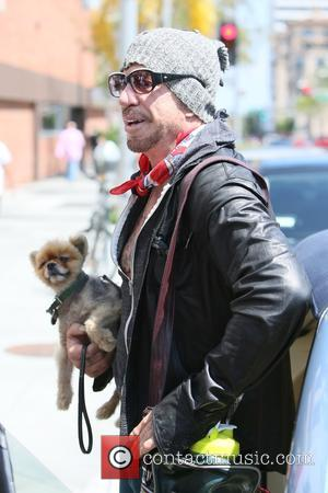 Mickey Rourke - Mickey Rourke seen leaving Cafe Roma at Beverly Hills - Los Angeles, California, United States - Thursday...