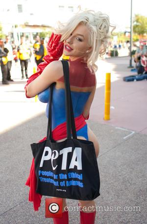 Courtney Stodden - Courtney Stodden dons Miss Marvel body paint to hand out fliers on behalf of PETA at Comic...