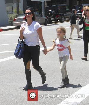Kyle Richards and Portia Umansky - Kyle Richards holds hands with her daughter as they go shopping in Beverly Hills...