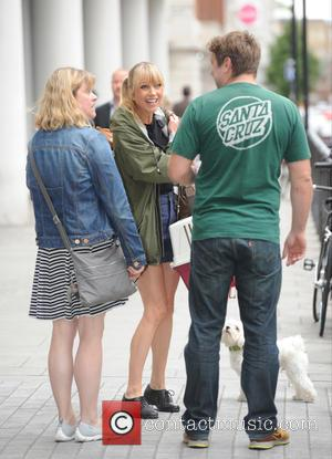 Sara Cox - Sara Cox leaving the BBC Radio 1 studios with her dog - London, United Kingdom - Tuesday...