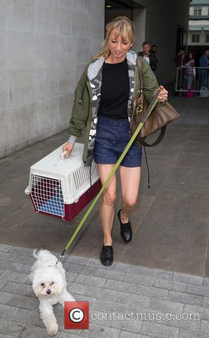 Sarah Cox - Sarah Cox leaving the Radio 1 studios with her small white dog on a leash at BBC...