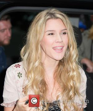 Joss Stone - Joss Stone pictured leaving the Radio 1 studios with small dog at BBC Portland Place - London,...