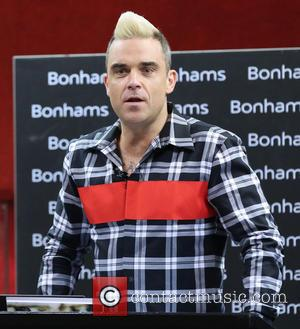 Robbie Williams Is Reportedly In Talks To Reunite With Take That Again