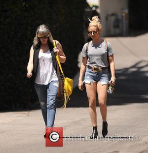 Ashley Tisdale - Ashley Tisdale wears short sorts out to lunch with a friend - Los Angeles, California, United States...