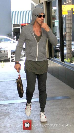 Mickey Rourke - Mickey Rourke goes to Cafe Rome in Beverly Hills in a grey hoodie and patriotic stars and...