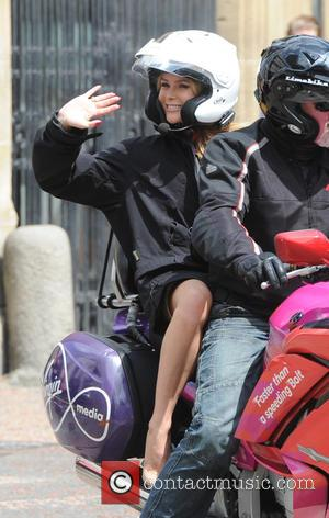 Amanda Holden - Amanda Holden leaving the ITV studios on the back of a motorcyle taxi - London, United Kingdom...