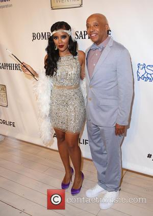 Angela Simmons and Russell Simmons