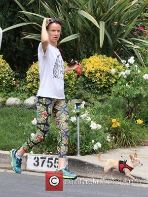 Juliette Lewis and Teddy - Juliette Lewis wears no make-up while she takes a morning walk with her dog Teddy...