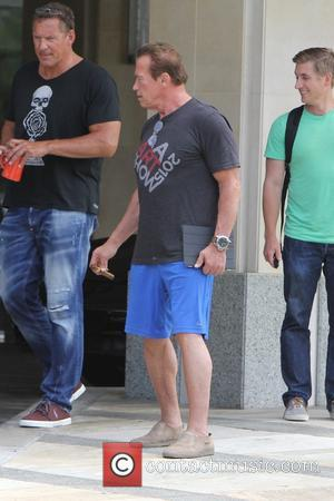 Arnold Schwarzenegger - Arnold Schwarzenegger out shopping in brentwood, smoking a cigar - Los Angeles, California, United States - Tuesday...