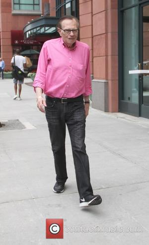 Larry King - Larry King goes shopping in Beverly Hills in a pink shirt, jeans and Nike sneakers - Los...