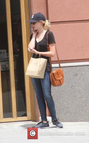 Sara Paxton - Actress Sara Paxton busy talking on her cell phone as she goes shopping in Beverly Hills -...