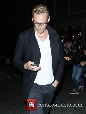 Tom Hiddleston - Tom Hiddleston and Elizabeth Olsen leave The Wolseley restaurant in Mayfair - London, United Kingdom - Thursday...