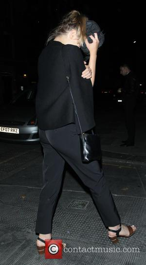 Elizabeth Olsen - Tom Hiddleston and Elizabeth Olsen leave The Wolseley restaurant in Mayfair - London, United Kingdom - Thursday...