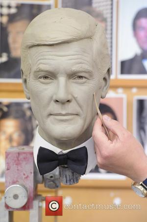 Principal sculptor Stephen Mansfield is pictured working on the wax figure sculpt of Roger Moore, as Madame Tussauds London announces...