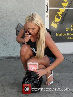 Mary Carey - Mary Carey leaves Romantix adult bookstore, dropping her purchase on the way out at North Hollywood -...