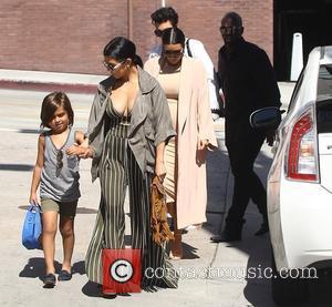 Corey Gamble, Kim Kardashian, Kourtney Kardashian and Mason Disick