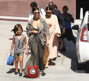 Corey Gamble, Kim Kardashian, Kourtney Kardashian and Mason Disick