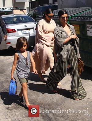 Kim Kardashian, Kourtney Kardashian and Mason Disick