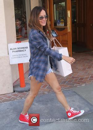Robin Antin - Pussycat Dolls founder Robin Antin shopping in Beverly Hills in a checked shirt, daisy dukes and red...