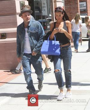 Shifty Shellshock and Seth Binzer - Crazy Town frontman Shifty Shellshock goes shopping in Beverly Hills with a female companion...