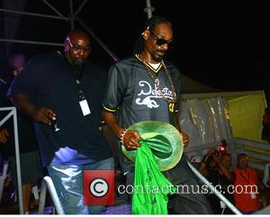 Snoop Lion and Snoop Dogg - Snoop Dogg performing live on stage at Arenile Reload where he was given a...