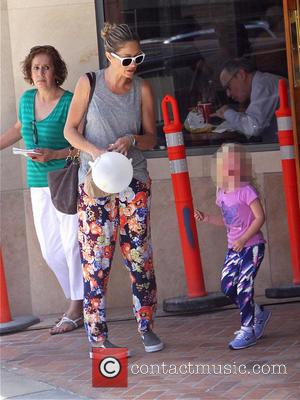 Rebecca Gayheart and Georgia Dane - Eric Dane and Rebecca Gayheart get a parking ticket while out and about in...