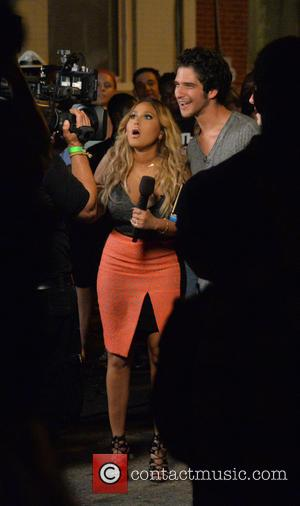 Adrienne Bailon and Tyler Posey