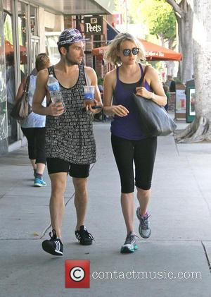 Taylor Schilling - Orange Is the New Black star Taylor Schilling goes to the gym with a male companion -...