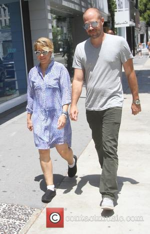 Yeardley Smith - Yeardley Smith goes shopping in Hollywood with a male companion - Los Angeles, California, United States -...