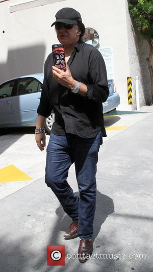 Gene Simmons - Gene Simmons shows off his Kiss phone cover in Beverly Hills - Los Angeles, California, United States...