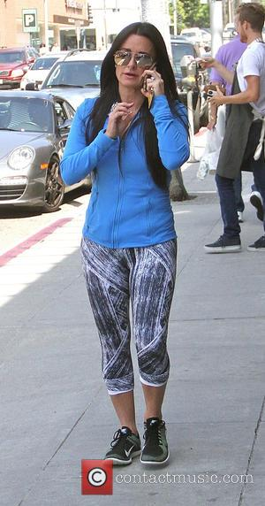 Kyle Richards - Kyle Richards talking on her cell phone as she goes shopping in Beverly Hills - Los Angeles,...