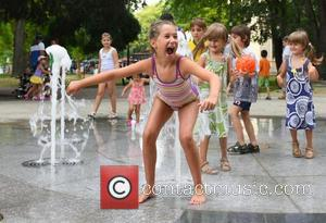 Bulgaria Hot Wave - Kids try to stay cool at a new builded fountain as  at Black sea town...