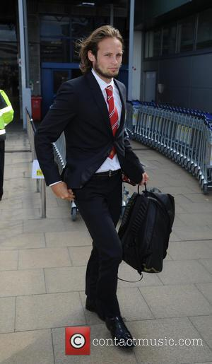 Daley Blind - Manchester United arrive at Manchester Airport after returning from their pre season USA Tour - Manchester, United...