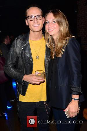 Oliver Proudlock and Guest - Superdry and Elite Models Final Show and Party - London, United Kingdom - Thursday 30th...