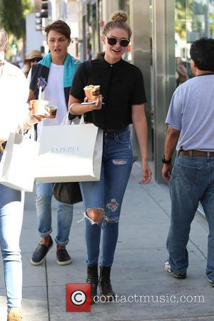 Gigi Hadid - Kendall Jenner and Gigi Hadid go shopping in Beverly Hills. The duo carried shopping bags from La...