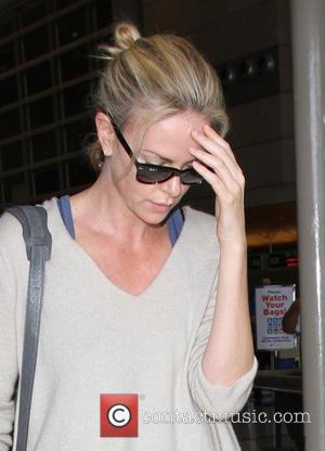 charlize theron , Charlize Theron - Charlize Theron arrives at Los Angeles International Airport (LAX) - Los Angeles, Cailfornia, United...