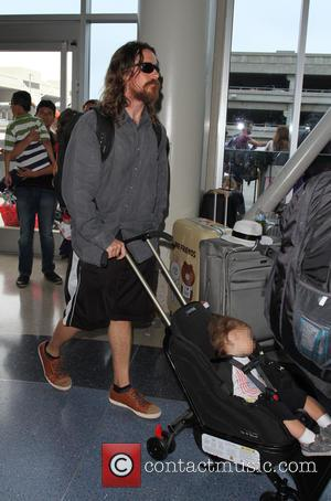 Christian Bale , Joseph Bale - Christian Bale arrives at Los Angeles International Airport (LAX) with his son Joseph Bale...
