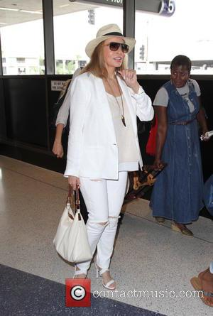 raquel welch - Raquel Welch arrives at Los Angeles International Airport (LAX) looking radiant in a white outfit - Los...