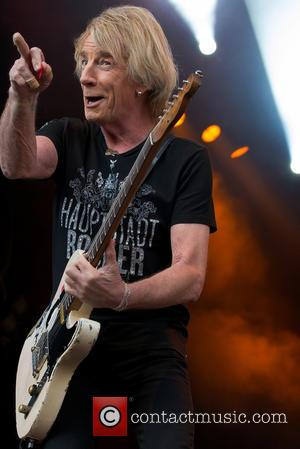 Status Quo , Rick Parfitt - Status Quo perform live at Liseberg amusement park in Gothenburg at Liseberg amusement park...