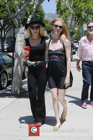 Jill Evyn - Jill Evyn and her girlfriend go shopping at Kitson and share a kiss on the street -...