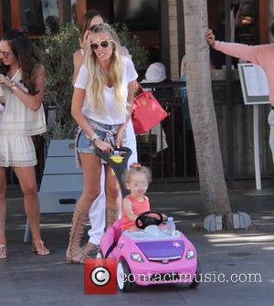 Petra Ecclestone , Lavinia Stunt - Sisters Tamara and Petra Ecclestone shop with their children and their mother Slavica at...