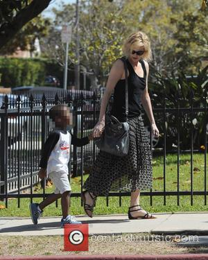 Charlize Theron , Jackson - Actress Charlize Theron heads to a friends in Los Angeles house with son Jackson after...