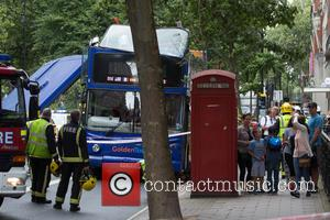 Atmosphere - A London tour bus has its roof ripped off by a tree near Woburn Place in London. -...