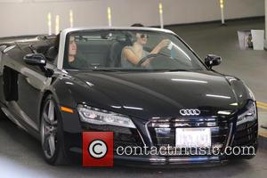 Kendall Jenner - Kendall Jenner drives her Audi R8 to Go Greek to fetch frozen yogurt with a male friend...