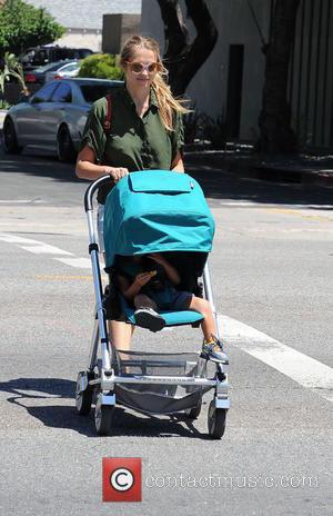 Teresa Palmer , Bodhi Webber - Teresa Palmer pushes an aqua blue stroller with son Bodhi across a street in...