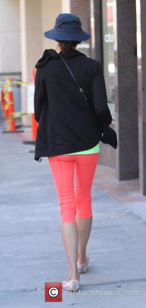 Janice Dickinson - Janice Dickinson gets a juice in Beverly Hills wearing pink neon leggings and green stripe neon top...