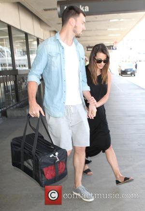Lea Michele , Matthew Paetz - Camera shy Glee star Lea Michele arrives at Los Angeles International Airport (LAX) hiding...