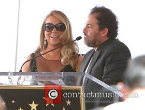 Mariah Carey and Brett Rattner