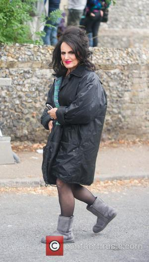 Lesley Joseph - 'Birds of a Feather' cast filming a funeral scene in Hertfordshire. The casket knocks Pauline on the...